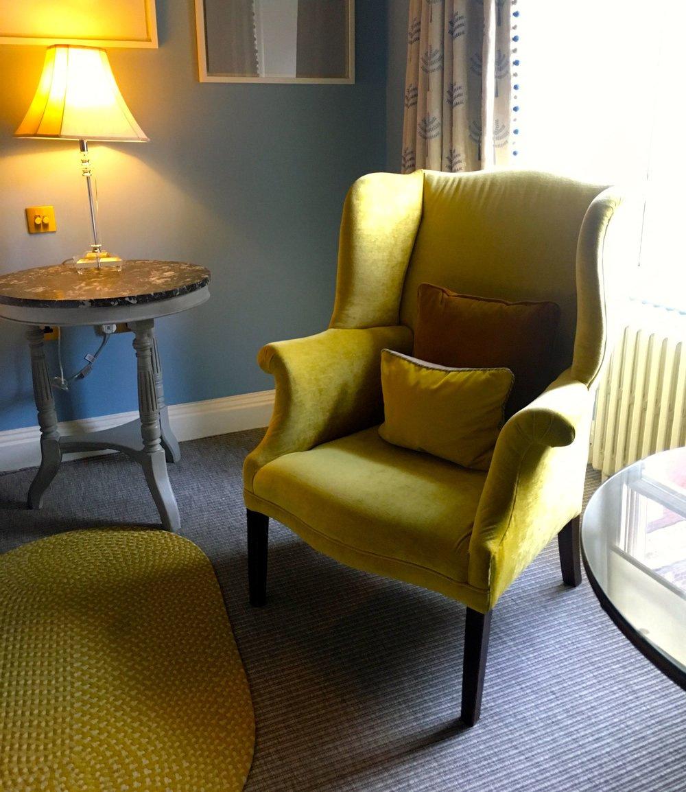 a winged arm chair