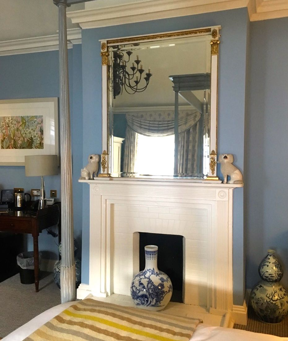 A fireplace with a mirror above