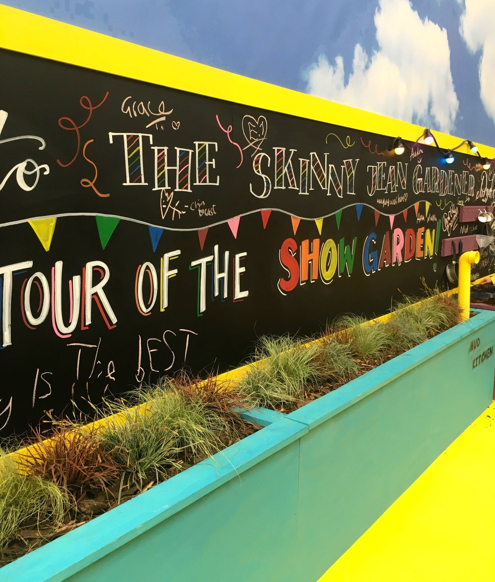 A colourful spot with a blackboard and planting