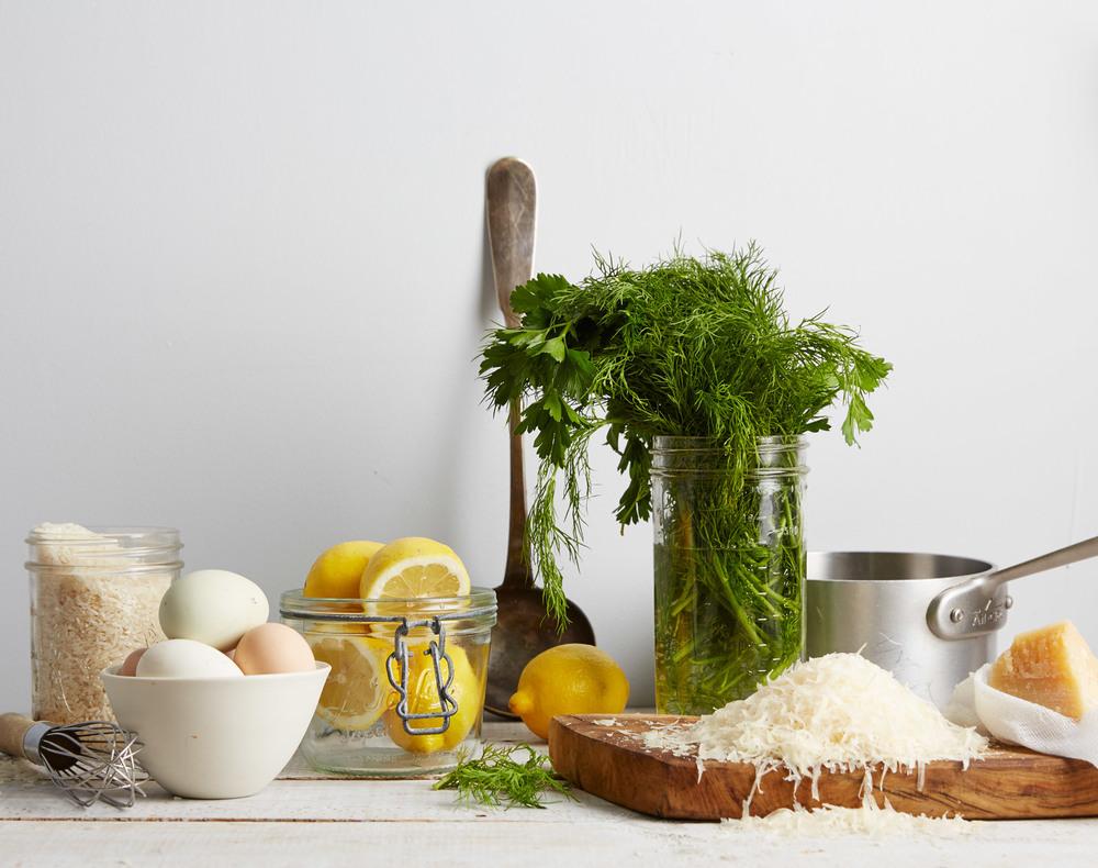ingredients for eggy lemon soup, rice, eggs, lemon, herbs, cheese, broth