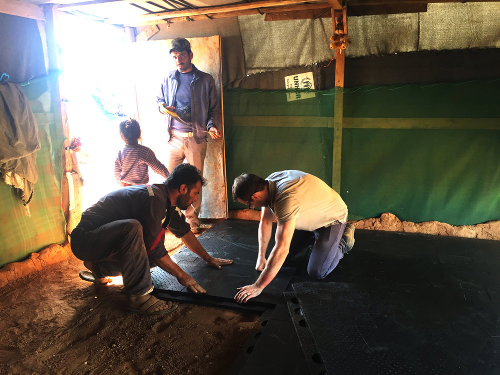 Co-Founder Sam Brisendine Installing Emergency Floor in a Shelter.