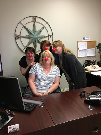 Our staff having fun with their red noses!