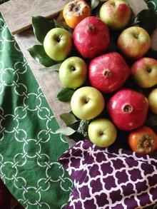 Easy fruit centerpiece on cotton tablecloth green
