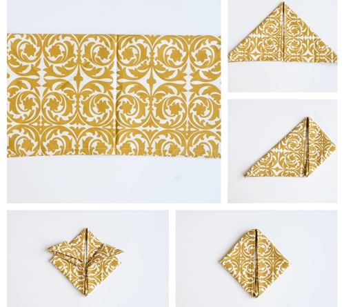 cloth napkin folding gold and white