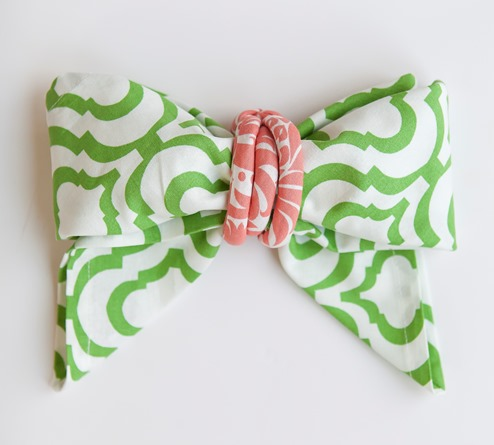 green and white cotton dinner napkin fold