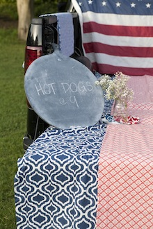 fourth of july party sign and red white and blue linens