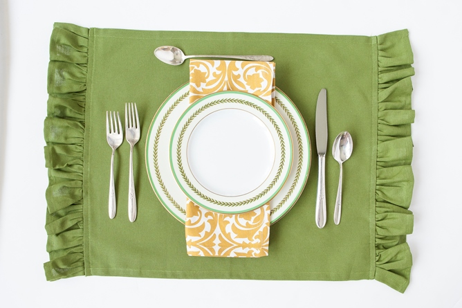green cotton placemat gold and white cotton dinner napkin