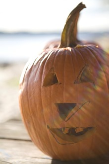 carved pumpkin on dock