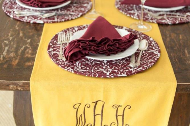 gold and claret cotton table linens