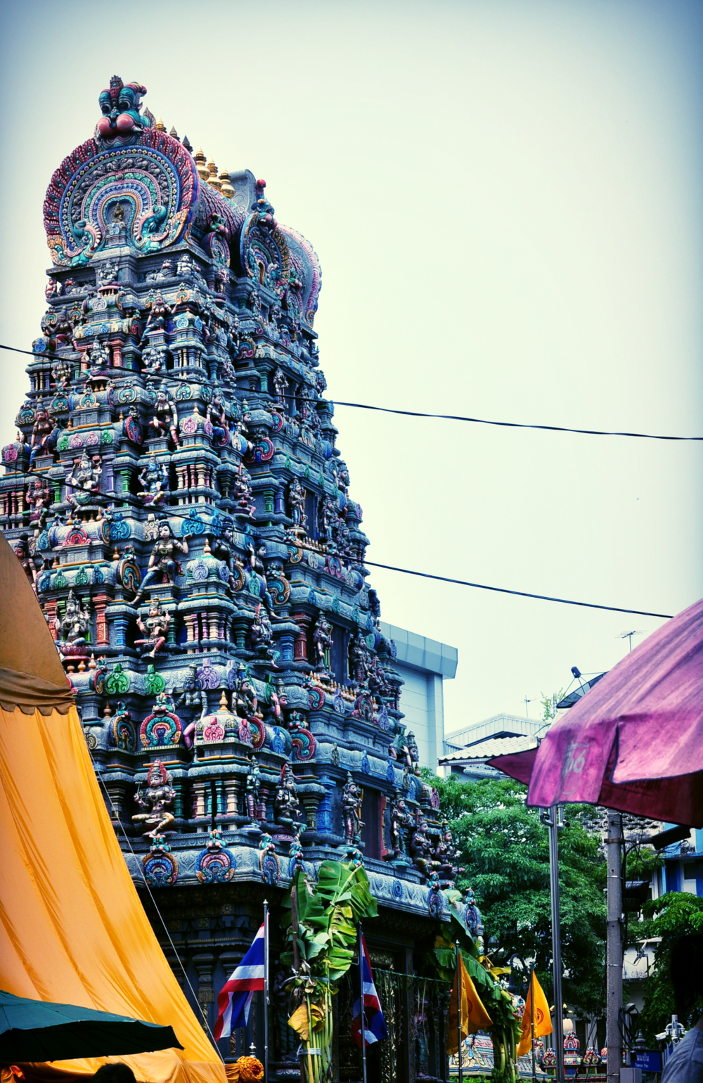 "The Hindu Temple or ""Wat Kaek"" is situated in front of ""Thanon Pan"" if you enter from Silom Road."