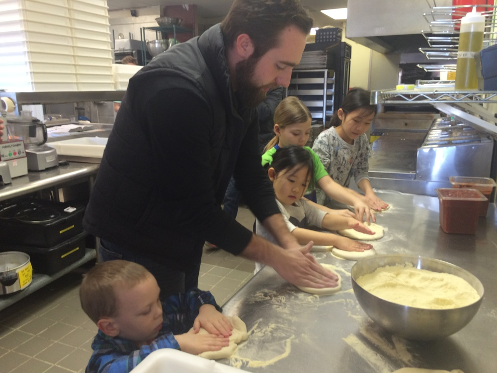 Jonathan Cowan teaching pizza making to all the winners of the Orland Park Prairie's annual Valentine's Day coloring contest at Wooden Paddle Pizza.