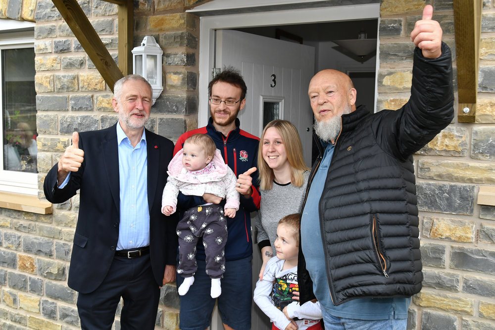 Jeremy Corbyn and Michael Eavis with residents in Pilton