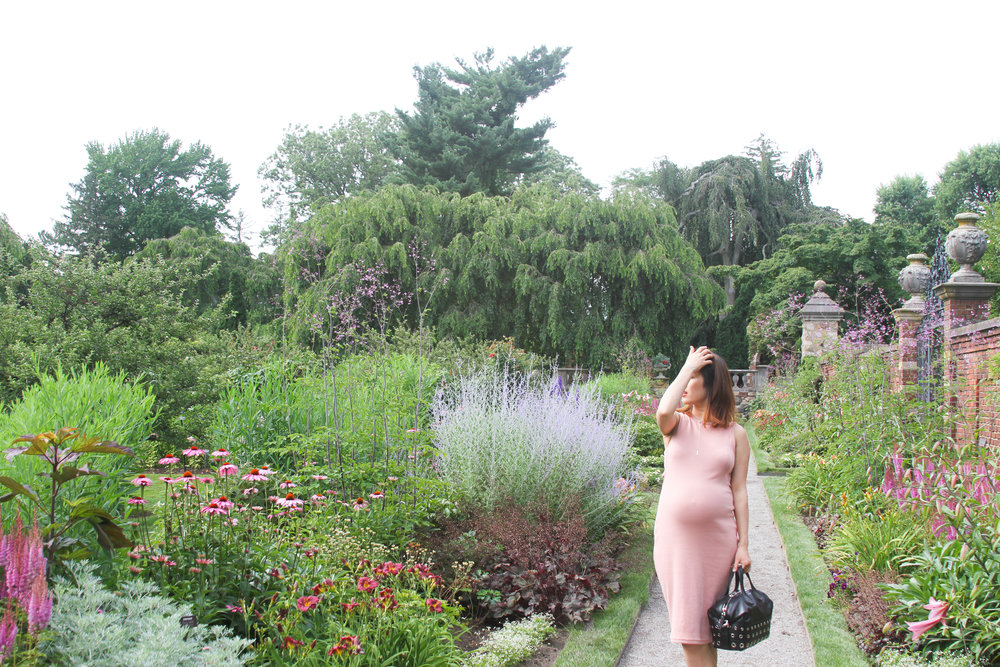 junelemongirl, fashion blogger, new york, long island, street style, maternity style, old westbury gardens, pink dress, midi dress, cutout dress, cutout knit dress, stud tote, medium stud detail leather nightingale, Givenchy bag, black tote, black satchel, silver bracelet, henri bendal bracelet, silver ear jacket, mom style, maternity look, ootd, new york fashion blogger