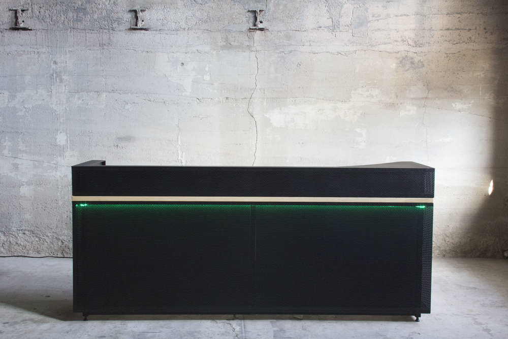 Perforated steel reception desk by Synecdoche Design Studio for Duo Security Ann Arbor