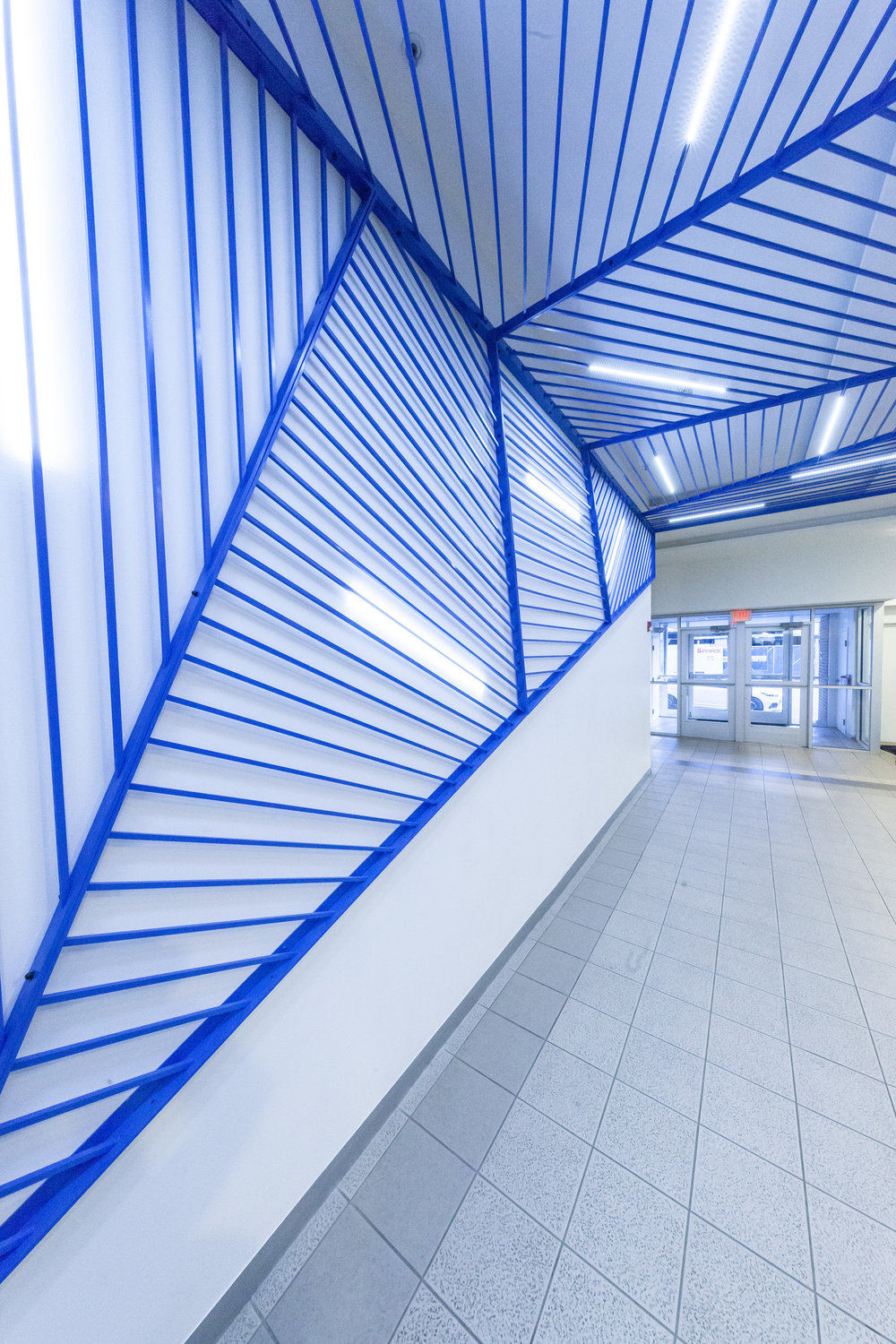 Blue line light lobby installation by Synecdoche Design Studio