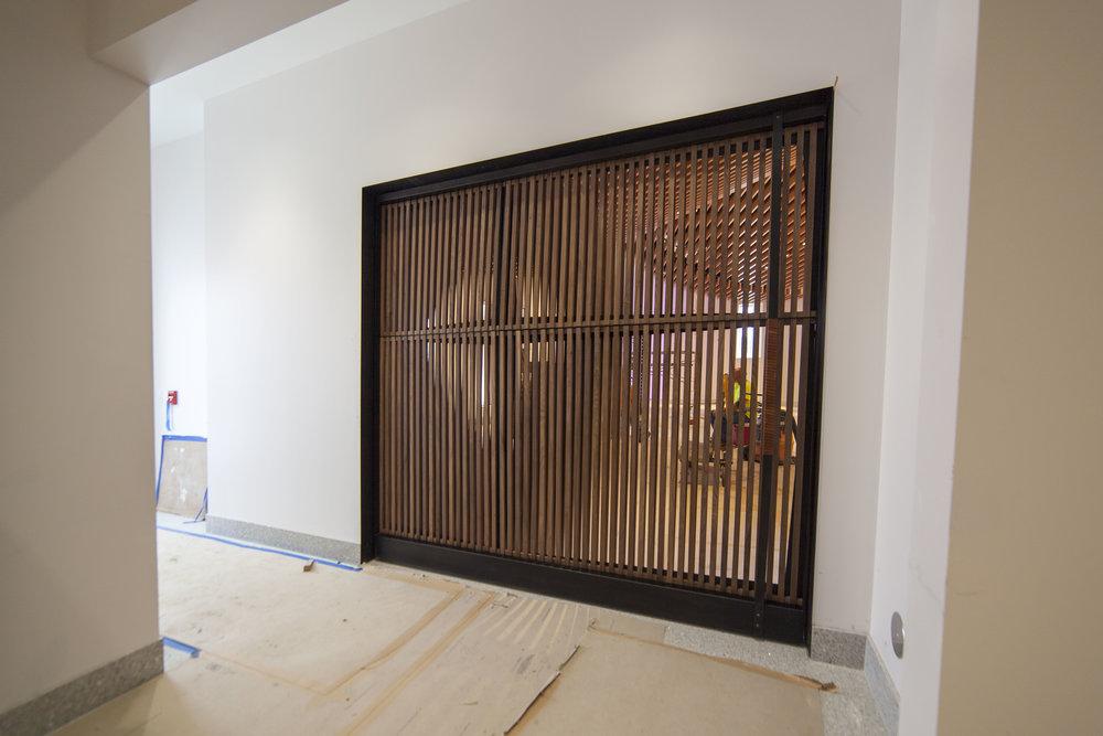 Chapel Pivot Door by Synecdoche Design Studio