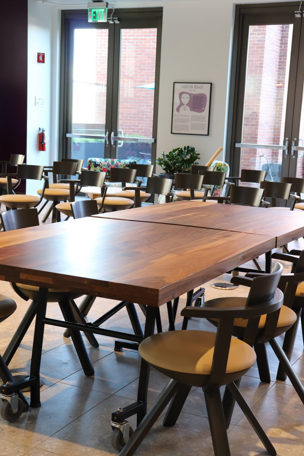 Walnut fold up cafeteria tables by Synecdoche Design Studio