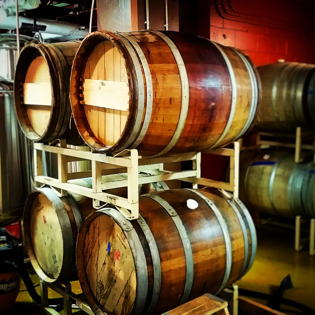 Fermentation and aging in reused oak wine barrels.