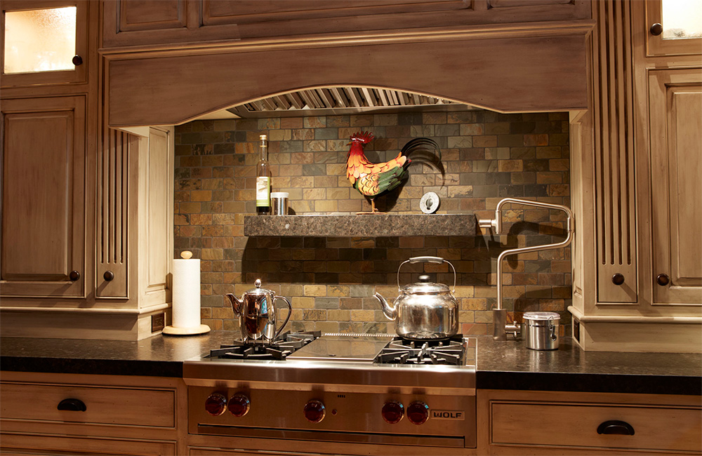 Even this backsplash is finished with warm earthen tile in this celebration of the natural.