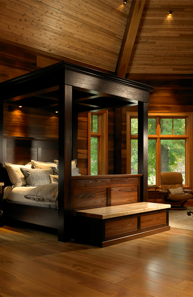 The octagonal master bedroom with a circumference of true-divided lite windows is a magnificent treetop retreat.