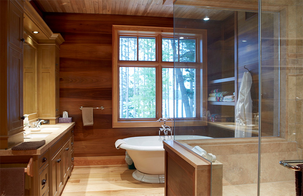 Even the naturally-lit master bath enjoys lakeside forested views …