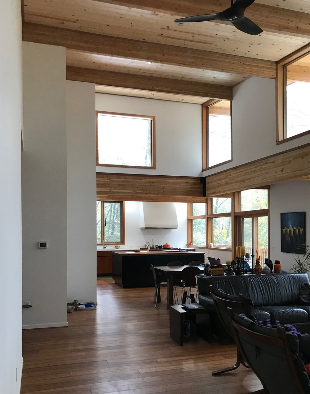 One great room. As the space and their functions go from more to less communal, this great room gets progressively narrower.