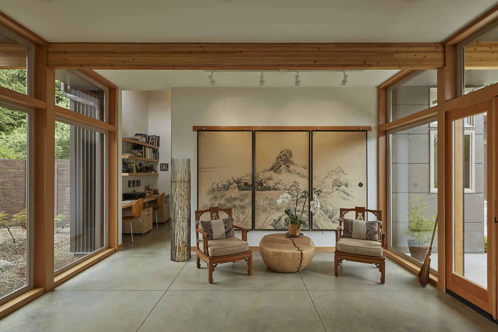 Transparent entry opens onto Japanese garden