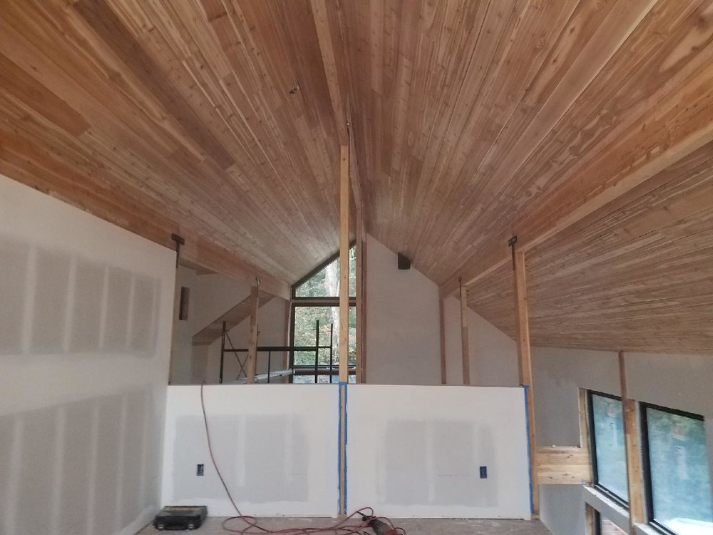Beautifully finished Lindal tongue and groove cedar lines the roof, and radiates warmth,  Shown here from the master bedroom