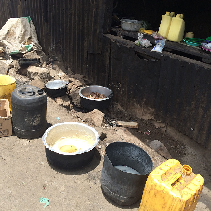 Roadside cooking on coals, again by open drains. A lack of food handling/ safety knowledge disease is a big risk
