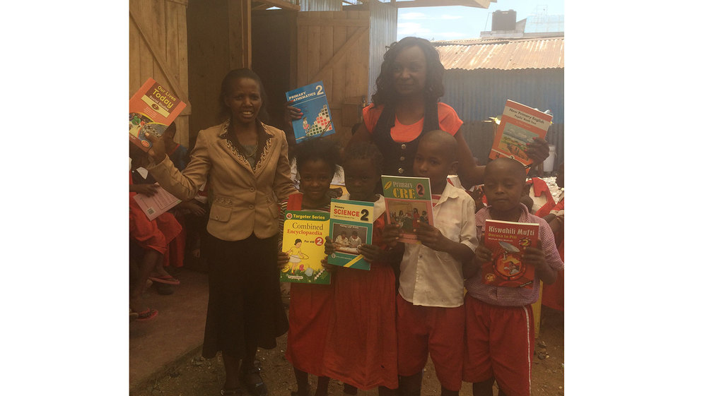 Jackie from SDI Kenya donating some of the books we bought to year 2