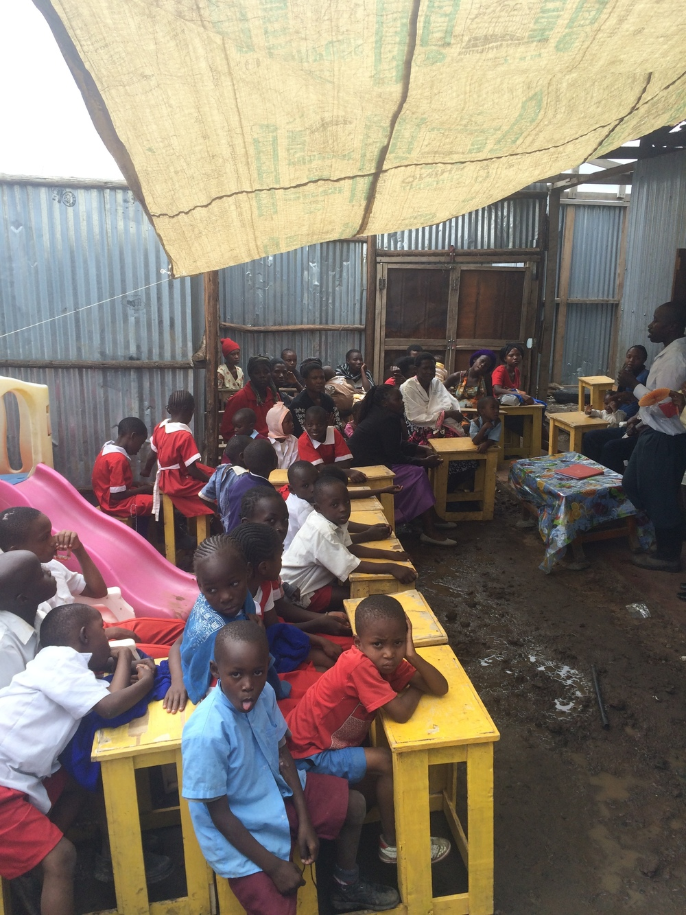 Parents, children and teachers at the school