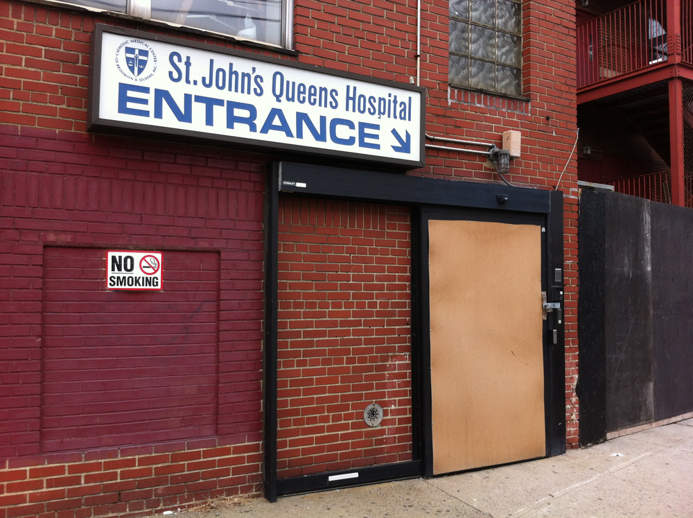 The boarded-up, rear entrance of St. John's Queens Hospital, as it looked like on March 5, 2013.  St. John's closed in bankruptcy in 2009.  Source :  Louis Flores