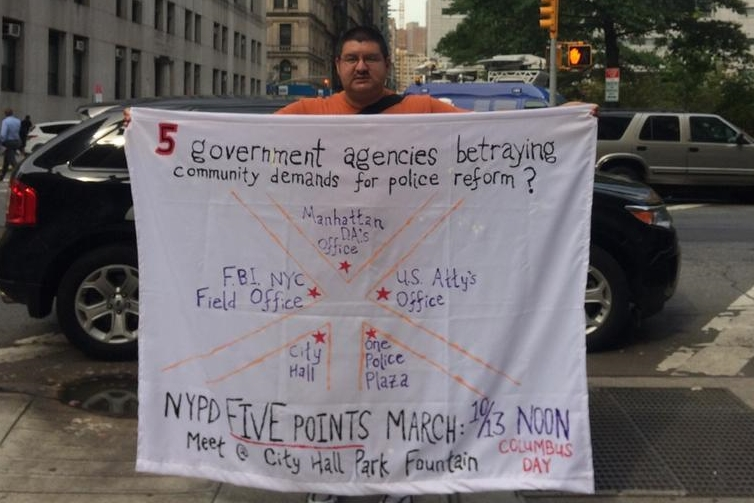 This protest banner announcing the  NYPD Five Points March  was unfurled outside the office of Manhattan District Attorney's Office on September 29.   Source  : File Photograph