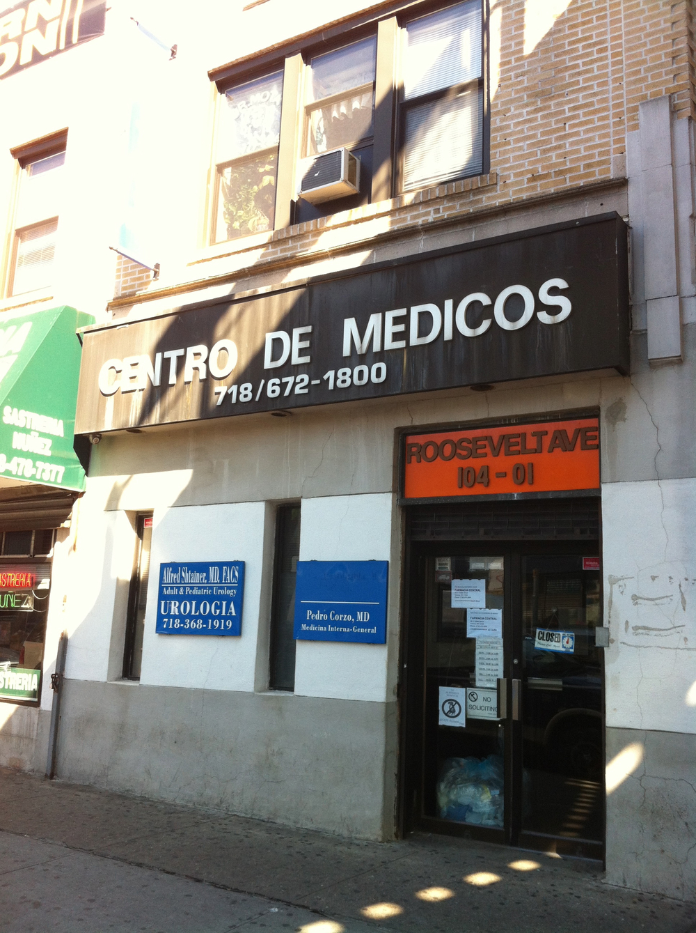 The medical office building on the corner of Roosevelt Avenue and 104th Street, as seen on October 5, 2014.  According to a 2009 report in  The New York Daily News , this office building was where each of :  the State Senator Peralta's mother worked, the State Senator once operated his campaign office, the State Senator used as the office for the  Corona-Elmhurst Center for Economic Development , and a partner in one of the State Senator's real estate investments operates her dentistry office.  Source : Louis Flores