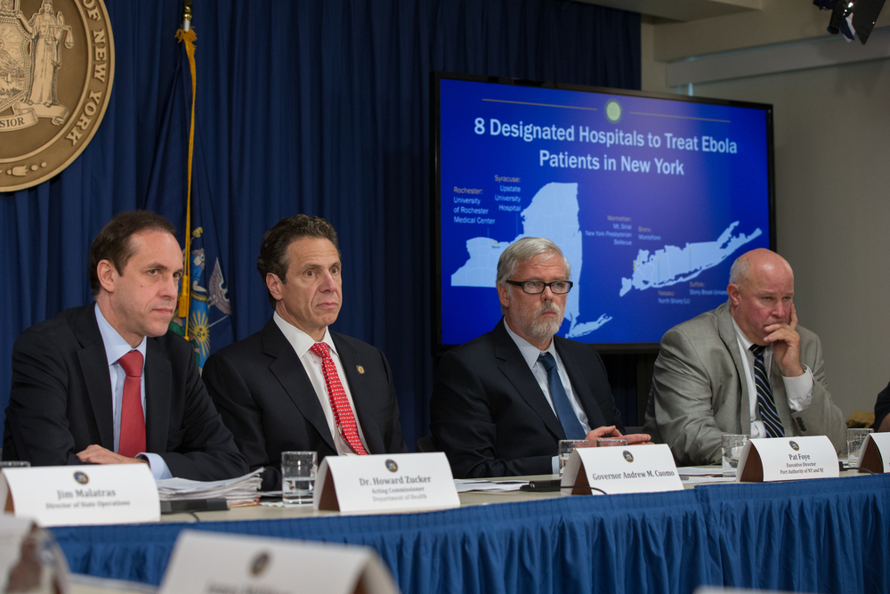Dr.  Howard Zucker , the state's acting commissioner of the Department of Health ; Gov.  Andrew Cuomo  (D-NY) ;  Pat Foye,  executive director of the Port Authority of New York and New Jersey ; and  Tom Prendergast , chairman and chief executive officer of the Metropolitan Transportation Authority at the announcement last week of eight designated hospitals to receive and treat people with Ebola. Source :  Official Photograph/Governor's Office