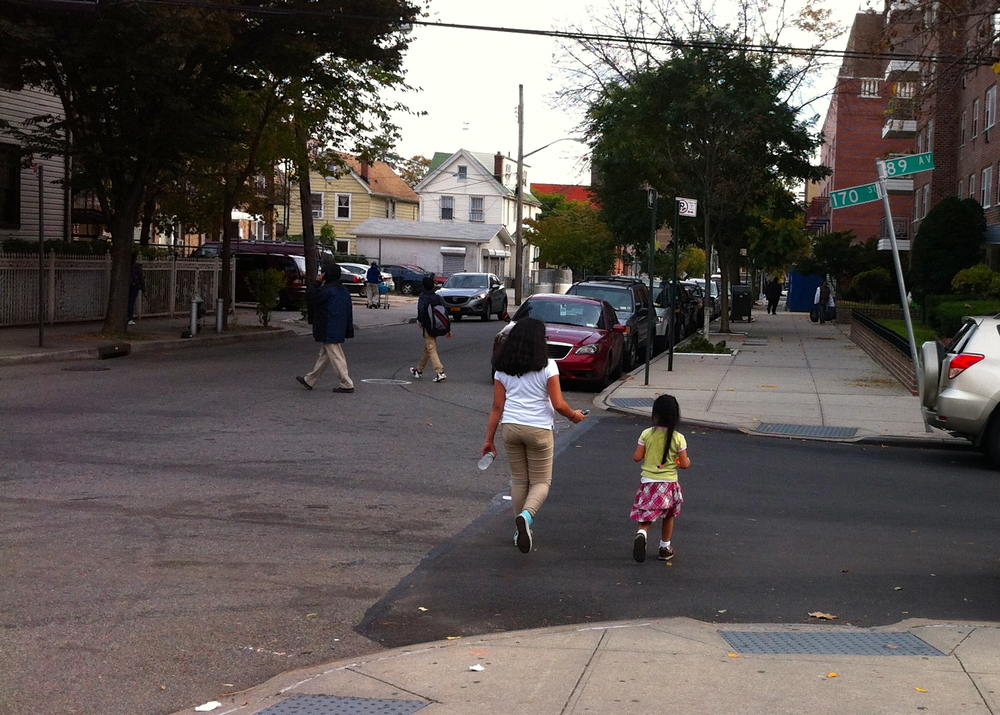 Two young girls walking along 170th Street crossed 89th Avenue.  Community residents are worried about the non-stop use by large and heavy commercial trucks of 170th Street as a short cut.  A few blocks from the intersection pictured here is another intersection that tied for second place as one of the most dangerous traffic intersections in Queens for the year 2010.  Source :  Louis Flores