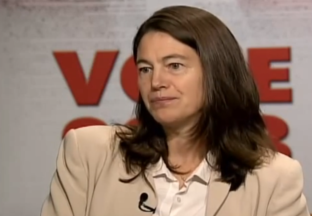 The powerful campaign consultant and lobbyist, Jennifer Cunningham, seen in a 2011 interview on CUNY TV 75.  Ms. Cunningham is Attorney General Eric Schneiderman's ex-wife.  She has provided campaign consulting services to her ex-husband, and she advises him in his capacity as Attorney General.  Her consulting firm, SKD Knickerbocker, was hired by Herbalife, which is facing an investigation from the New York State Attorney General's Office.  Source :  CUNYTV75/YouTube Screen Shot