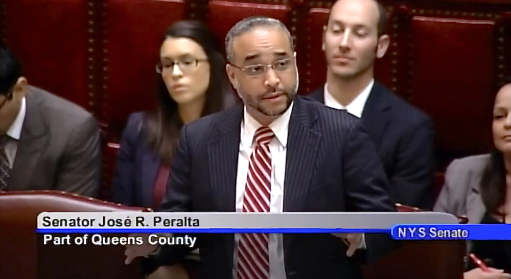 New York State Senator José Peralta, speaking on the floor of the New York State Senate on March 31, 2014, about a budget bill.  In his remarks that day, Senator Peralta reaffirmed his support for passage of the DREAM Act, proposed legislation that would provide college tuition assistance to undocumented New Yorkers.  Despite his advocacy on behalf of Latinos and Latino immigrants, Senator Peralta has been kept mum about the devastation wrought by Herbalife.  Source :  New York State Senate/YouTube Screen Shot