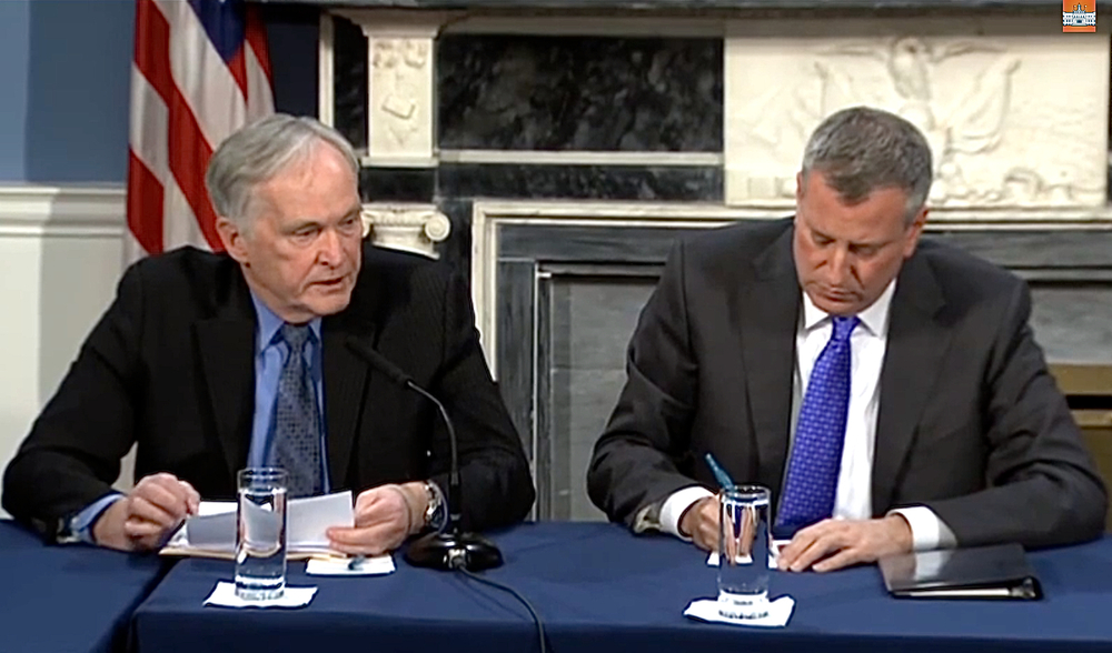 New York City Department of Corrections Commissioner  Joseph Ponte , left, reads from his statement at a media roundtable Thursday with Mayor  Bill de Blasio  at his side.  Source :  NYC Mayor's Office/YouTube Screen Shot