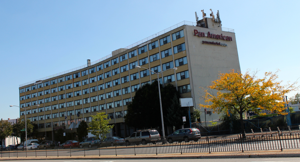Residents in Queens, including long-term immigrant residents, have opposed the conversions of hotel facilities into permanent homeless shelters, like the former Pan American Hotel, as seen on Oct. 3, 2014.  Queens is being targeted for rapid upscale real estate development at the same time when the borough is also paradoxically being chosen as the setting for a greater share of the city's homeless shelters and for more juvenile inmate detention centers.  Source :  Louis Flores