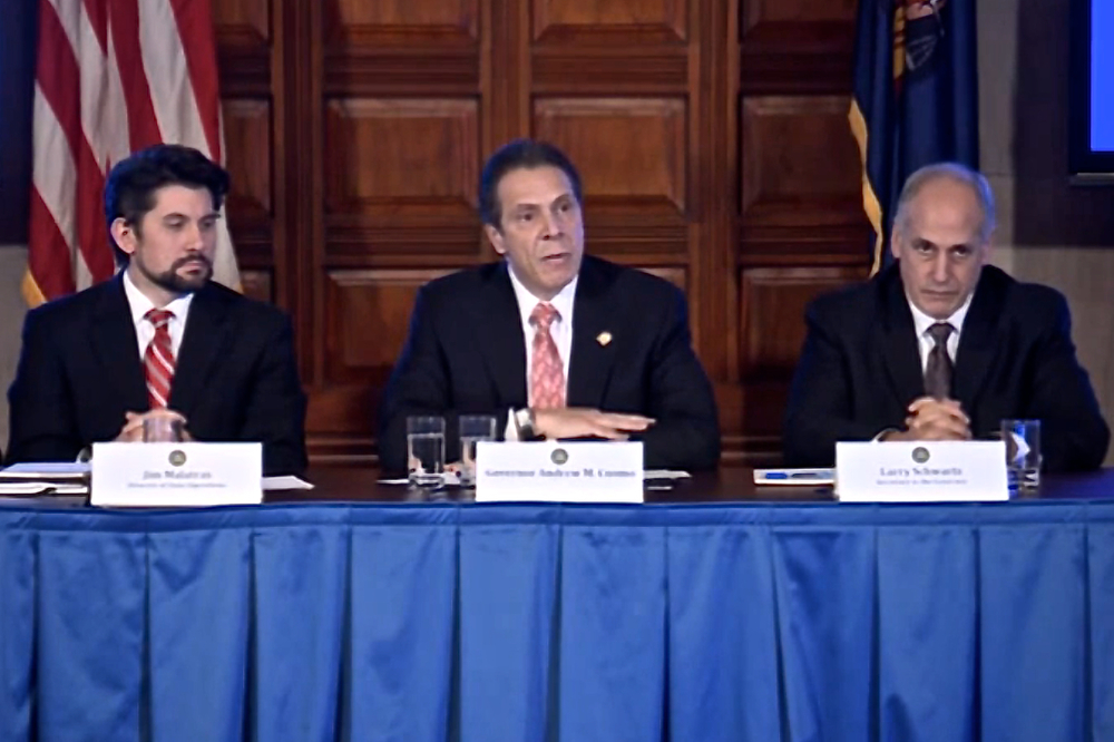 Left to right :  Jim Malatras, director of state operations ; Gov Andrew Cuomo ; and Lawrence Schwartz, the governor's secretary in a moment during the governor's cabinet meeting on Wednesday.  Source :  Official Gov. Cuomo YouTube Channel/Screen Shot