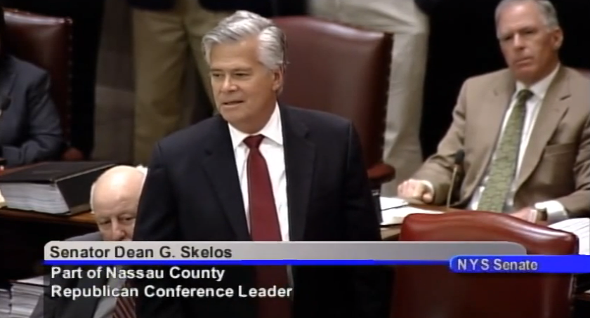 State Senator  Dean Skelos  (R-Rockville Centre), the Majority Leader, addressing the chamber in June 2014.  Reports indicated that Senator Skelos and his son,  Adam Skelos , face arrest next week on federal corruption charges.  Source :  New York State Senate/YouTube Screen Shot