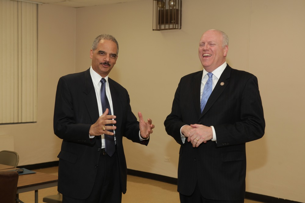 U.S. Representative Joseph Crowley (D-Queens), right, with former U.S. Attorney General Eric Holder, left, at a 2011 event.  U.S. Representative Crowley is the chair of the Democratic Party County Committee of Queens.  As such, he determines which officials run for office with the Democratic Party's institutional support.  Source :  Official Photograph/Office of U.S. Representative Joseph Crowley/Flickr