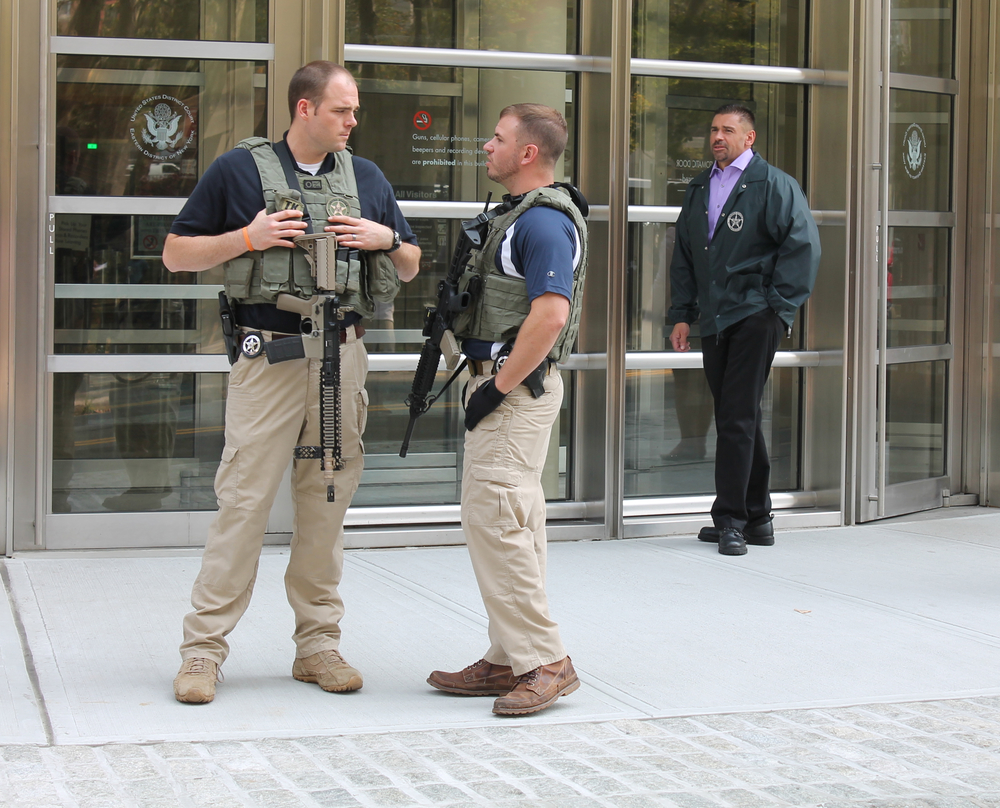 Federal marshalls guarded the entrance to the  U.S. District Courthouse  with automatic rifles with large capacity magazines in an effort to intimidate peaceful protesters during Thursday's rally.  Source :  Louis Flores/Progress Queens