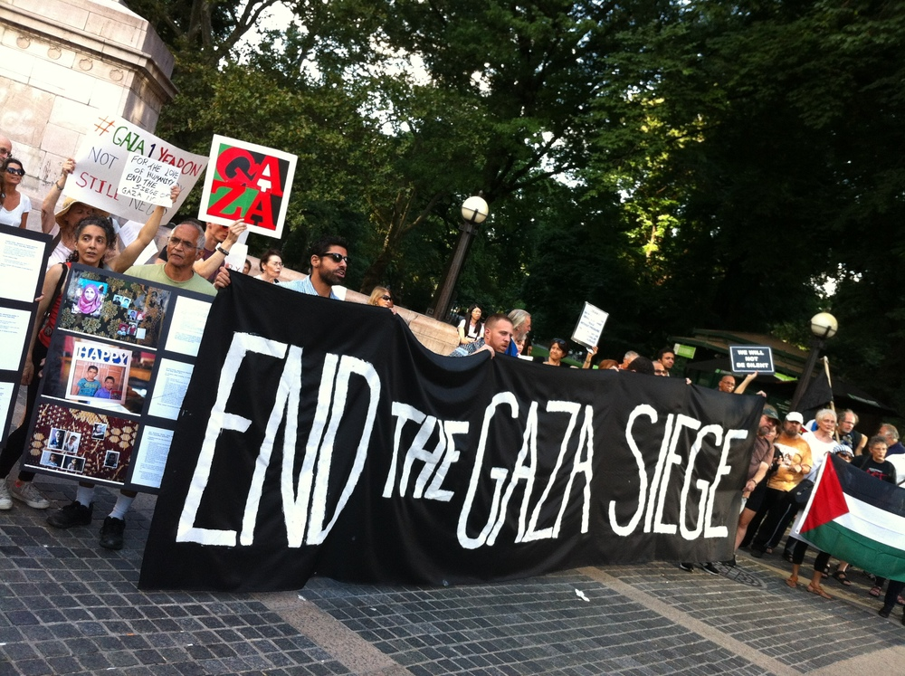 Members of a coälition of human rights groups, including the New York City chapter of  Jewish Voice for Peace , demonstrated on August 26, 2015.  Over 100 human rights activists marched from the  American Museum of Natural History  on the Upper West Side of Manhattan to Columbus Circle, seen here, to call for an end to the violence by the state of  Israel  against the  Palestinians .  Source :  Louis Flores/File Photograph