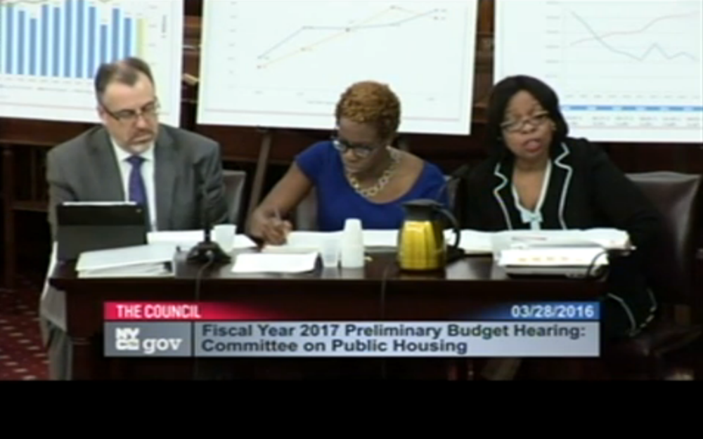 Left to right : Brian Clarke, senior vice president for operations ; Shola Olatoye, chief executive officer ; and Karen Caldwell, executive vice president and chief financial officer for the New York City Housing Authority, testifying at Monday's hearing.  Source :  Video Feed from New York City Council/Public Domain