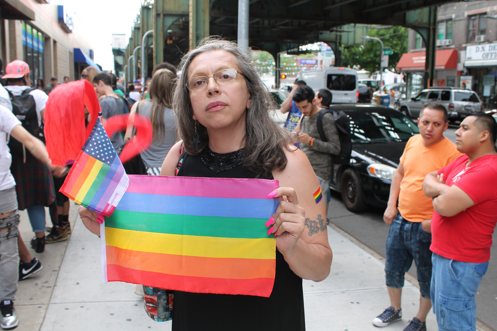 The activist  Brooke Cerda Guzmán  standing amongst dozens of activists and supporters outside the offices of Make the Road New York prior to the start of the  Trans Latina March . Source :  Louis Flores/Progress Queens