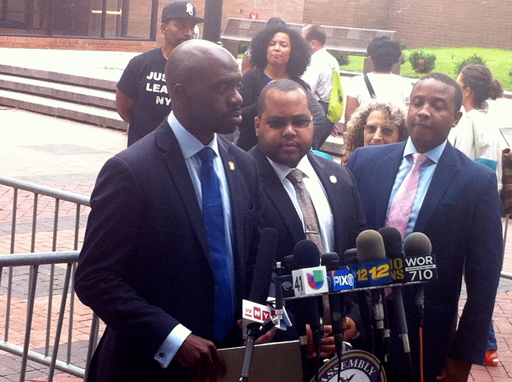 New York State Assemblymember Michael Blake (D-The Bronx), left, addressed the media outside One Police Plaza, headquarters for the New York Police Department. During the delivery of emotionally-charged remarks, Assemblymember Blake demanded that police officers be held to account for the use of excessive use of force. Source : Louis Flores/Progress Queens