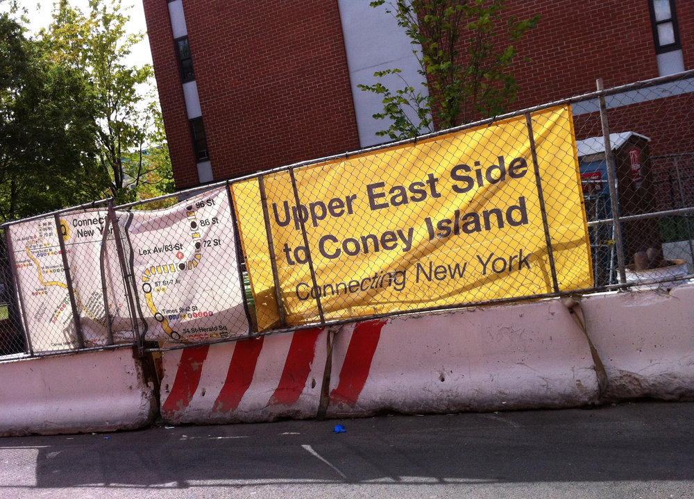 A staging area for materials used in the construction of the  Second Avenue Subway  was set up alongside East 101st Street near the southeast corner of Second Avenue. Metro Plaza North, a NYCHA public housing development where a water sample tested positive for lead at 1,249 ppb, was located one block from this staging area. Source : Louis Flores/Progress Queens