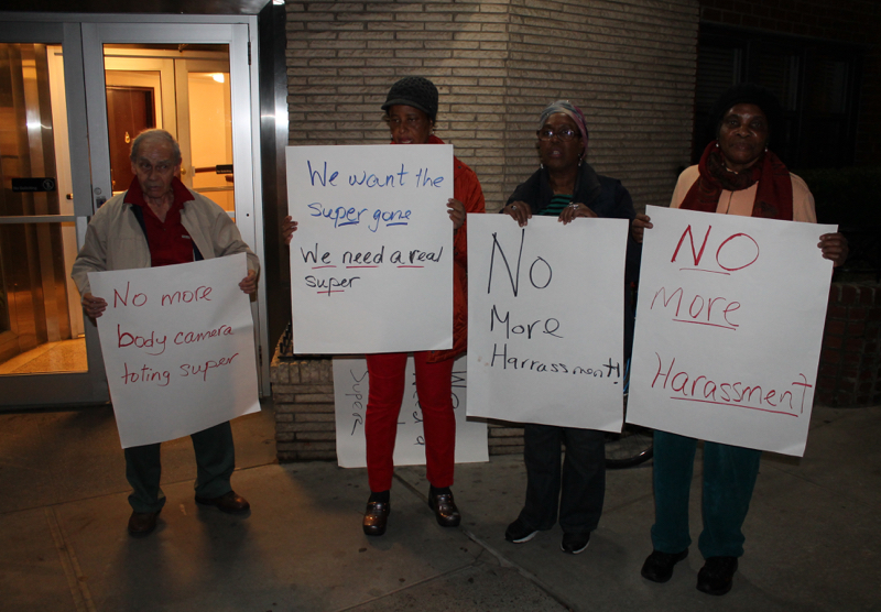 Some of the protesters, who demonstrated outside of 60 Turner Place in Brooklyn on Saturday evening, demanding better living conditions and the firing of the apartment building's superintendent,  Herchin Ablai . Source : Louis Flores/Progress Queens